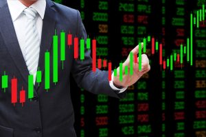 Businessman-hand-touching-Candlestick-Chart